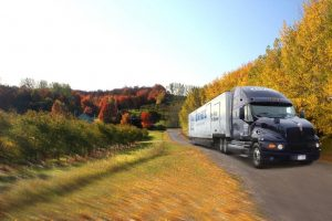 Moving truck driving in the fall