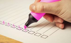 A moving checklist or to-do list being checked off