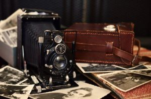 antique camera and photos on table