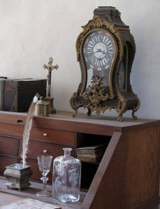 antique clock and other items on desk